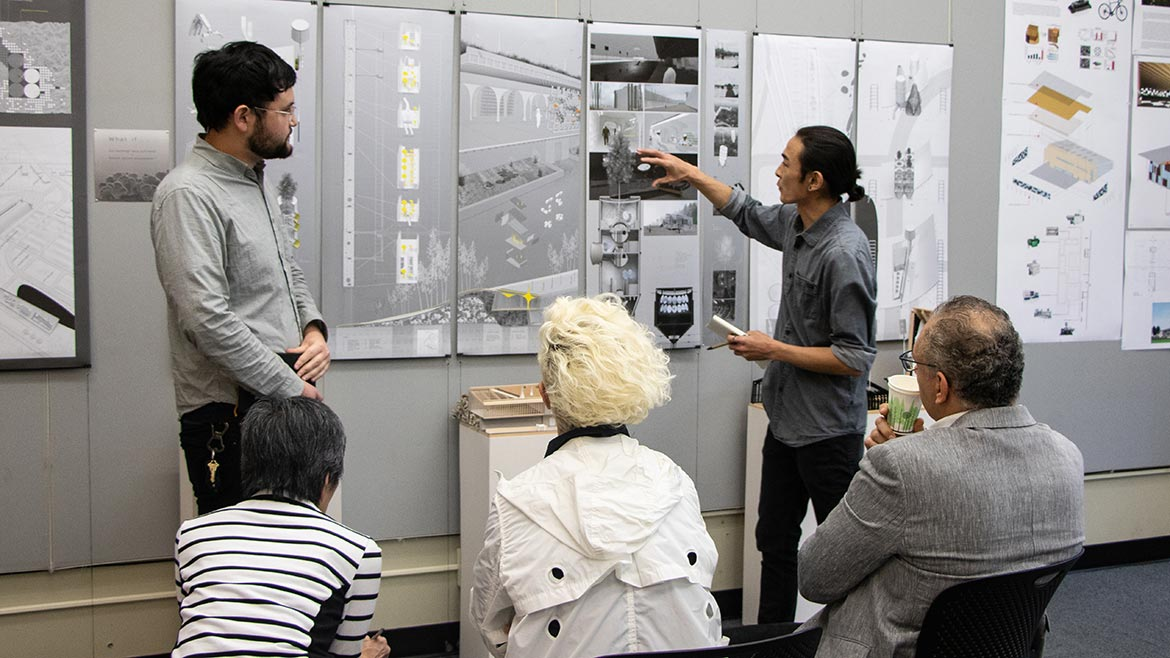 students discuss work at architecture review