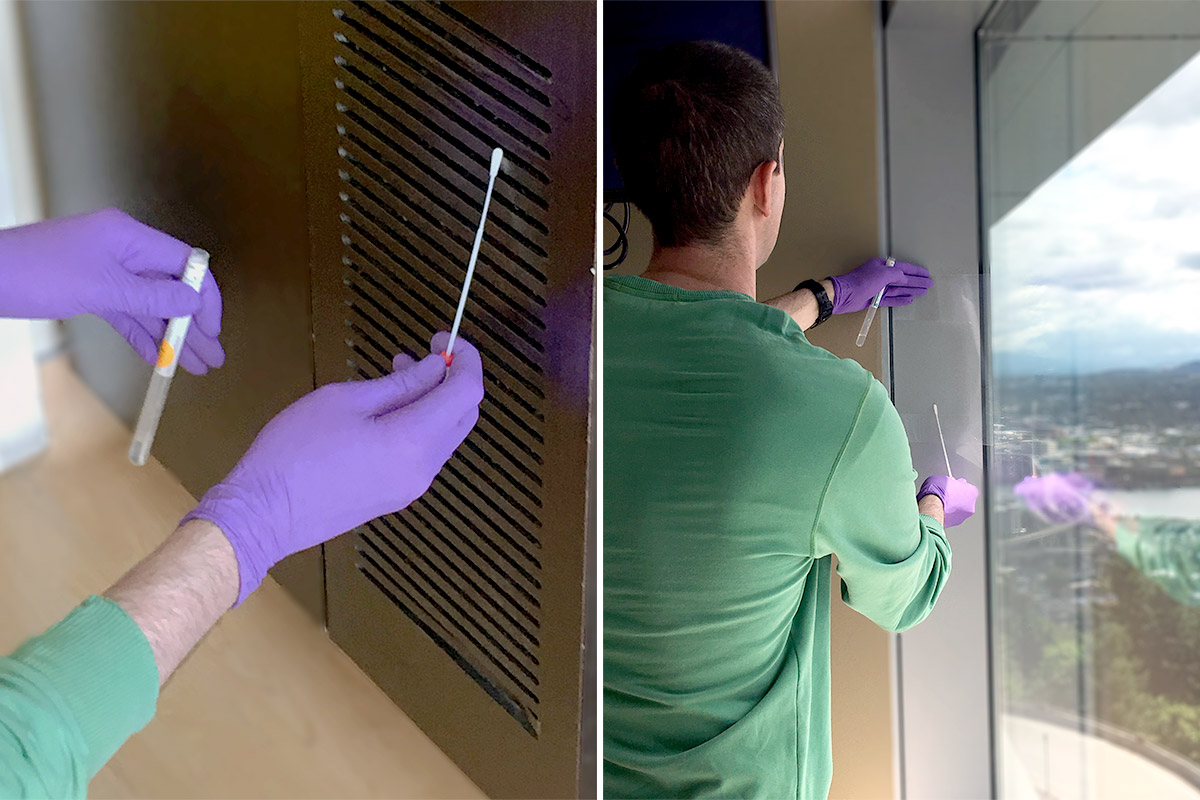 gloved hands gathering a sample on a vent with a swab