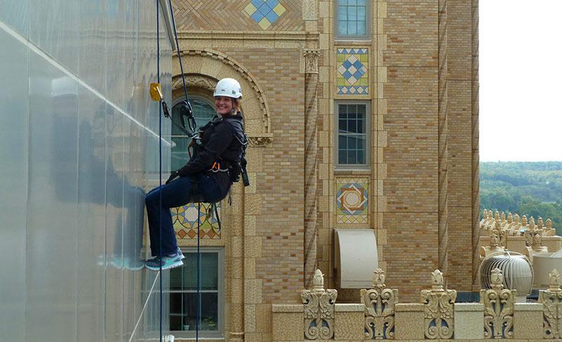 Chelsea Karrels rappelling down building