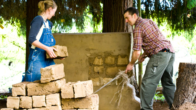 two students move bricks