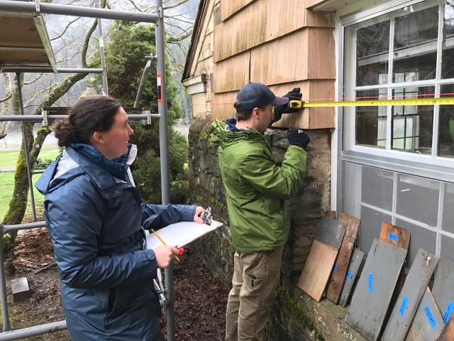 students work on wood window preservation