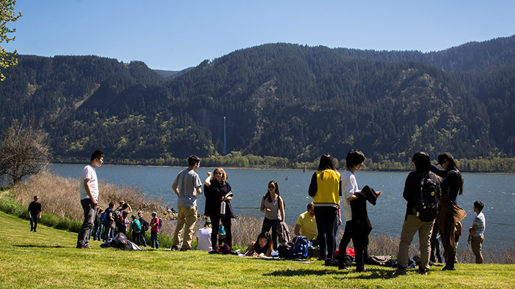 student field trip to the The Shire with Multnomah Falls in background