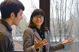 Professor Alison Kwok speaks with student