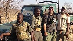 Jess Kokkeler with members of the International Anti-Poaching Federation team in Zimbabwe
