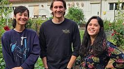 Photo of three students at the UO Urban Farm