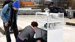 Students working on project on roof top