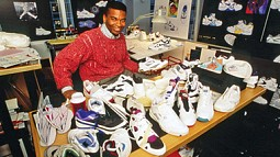 Wilson W. Smith III surrounded by shoes