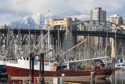Vancouver shipyard, city, and mountains